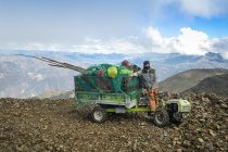 A Grillo tractor loaded with wood, working tools and rucksacks at 4000m above sea level in the Andes, Peru.